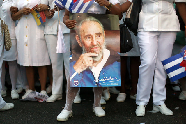 Medical personnel hold a picture of Cuba's former President Fidel Castro during a May Day rally in Havana, Cuba, May 1, 2016. (Photo by Alexandre Meneghini/Reuters)