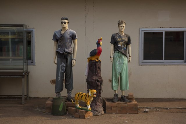 Mannequins with shirts and other souvenir clothing items for sale at Tiger Temple, where for a premium admission a visitor can bathe a tiger and even bottle-feed a cub, in Kanchanaburi, Thailand, March 16, 2016. (Photo by Amanda Mustard/The New York Times)