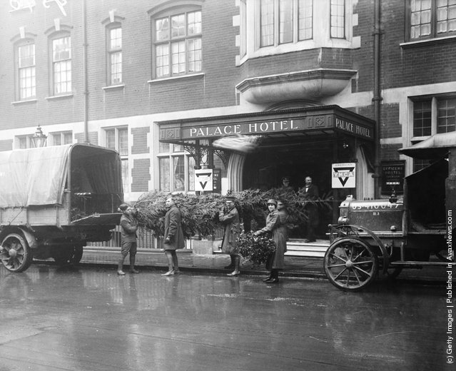 1918: Christmas trees being delivered for the members of the American army staying at the Palace Hotel in London