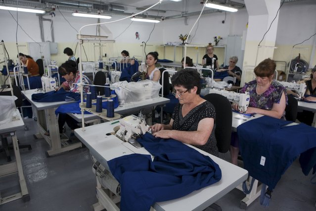 Employees of a garment factory work in Tskhinvali, the capital of the breakaway region of South Ossetia, Georgia, July 6, 2015. (Photo by Kazbek Basaev/Reuters)