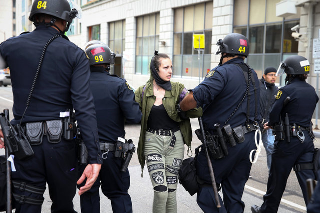 """A protester is arrested following a """"Patriots Day"""" free speech rally on April 15, 2017 in Berkeley, California. More than a dozen people were arrested after fistfights broke out at a park where supporters and opponents of President Trump had gathered. (Photo by Elijah Nouvelage/Getty Images)"""