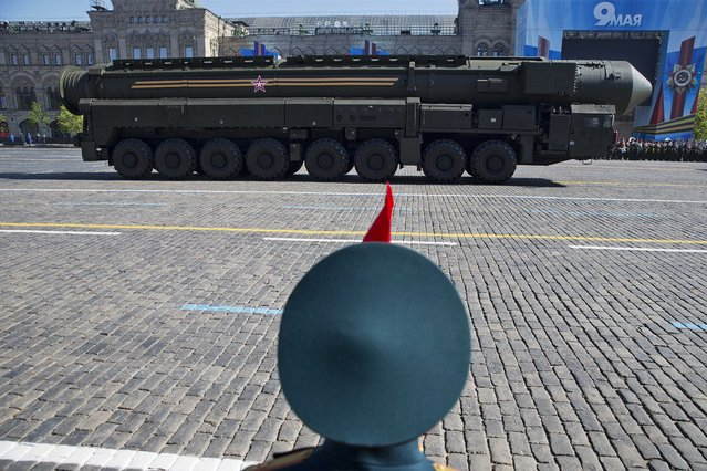 Russian intercontinental ballistic missile Topol-M rolls across Red Square during the Victory Day Parade, which commemorates the 1945 defeat of Nazi Germany in Moscow, Russia, Friday, May 9, 2014. Thousands of Russian troops march on Red Square in the annual Victory Day parade in a proud display of the nation's military might amid escalating tensions over Ukraine. (Photo by Pavel Golovkin/AP Photo)