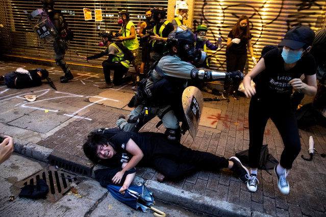Riot police officers clash with anti-government protesters during a demonstration in Causeway Bay district in Hong Kong, China on October 6, 2019. (Photo by Athit Perawongmetha/Reuters)