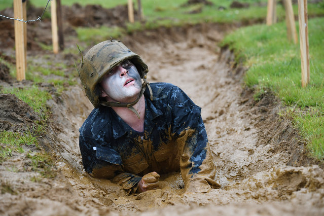 United States Naval Academy plebe, Richard Gremillion crawls through mud as he takes part in Sea Trials at the United States Naval Academy on Tuesday May 17, 2016 in Annapolis, MD. (Photo by Matt McClain/The Washington Post)