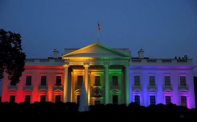 The White House is illuminated in rainbow colors after today's historic Supreme Court ruling legalizing gay marriage in Washington, in this June 26, 2015 file photo.  This picture is the most popular. (Photo by Gary Cameron/Reuters)