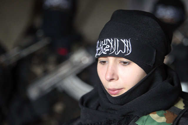 Um Jaafar, a woman fighter in the Free Syrian Army, rests while undergoing military training with other women in Aleppo February 17, 2013. Um Jaafar was a women's hairdresser before the revolution and was trained by her husband Abu Jaafar, a Sawt al-Haq battalion commander, to be part of Sawt al-Haq. (Photo by Muzaffar Salman/Reuters)