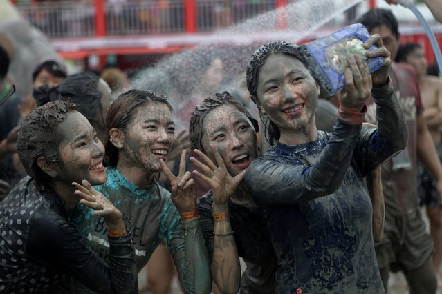Festival-goers enjoy the mud during the annual Boryeong Mud Festival at Daecheon Beach on July 18, 2015 in Boryeong, South Korea. (Photo by Chung Sung-Jun/Getty Images)