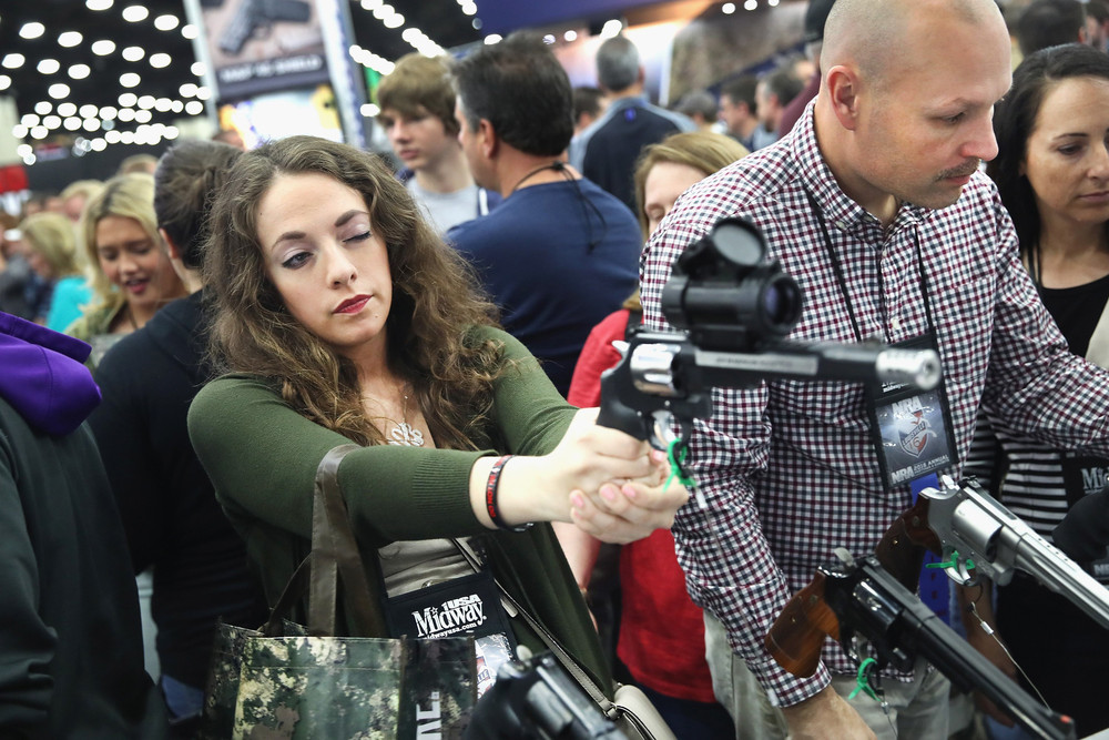 Gun Fans Admire Weapons at NRA Meeting