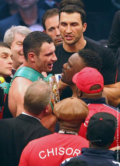 Vitali Klitschko (3rdL) of Ukraine discusses with Dereck Chisora of the UK after their WBC heavyweight World Championship title fight