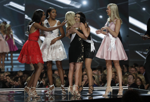 Contestants who made it in the top ten celebrate during the Miss USA contest Sunday, May 14, 2017, in Las Vegas. (Photo by John Locher/AP Photo)