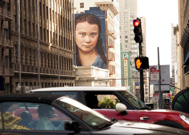 A mural on a side of a building depicts Swedish teenage climate activist Greta Thunberg, near Union Square in downtown San Franicsco, California, USA, 12 November 2019. The mural of Thunberg was painted by Argentinian muralist Andres Iglesias, who is also known as Cobre. (Photo by John G. Mabanglo/EPA/EFE)