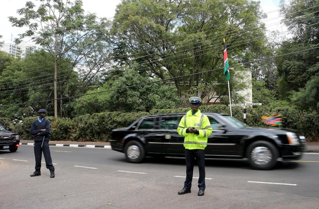 A policeman stands guard as the convoy of U.S. President Barack Obama drives to the State House in Kenya's capital Nairobi July 25, 2015. Obama told African entrepreneurs in Kenya on Saturday they could help counter violent ideologies and drive growth in Africa, and said governments had to assist by ensuring the rule of law was upheld and by tackling corruption. (Photo by Boniface Mwangi/Reuters)