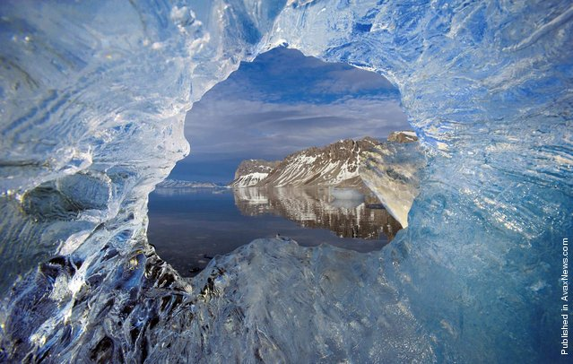 The hole in the ice of the glacier Hornsund, The archipelago of Svalbard