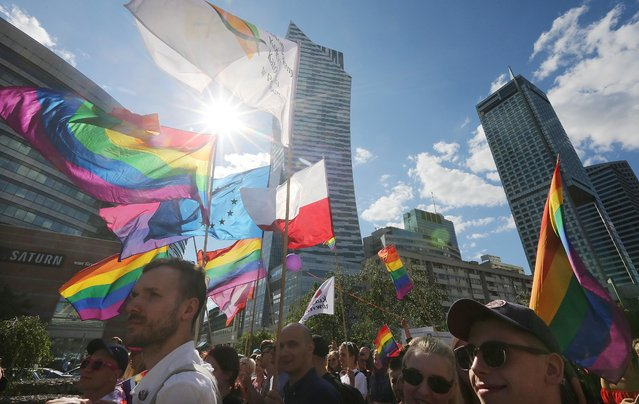Thousands of Warsaw residents with rainbow flags walk in a colorful annual Equality Parade to show their support for sexual minority groups  in Warsaw, Poland, Saturday, June 11, 2016. (Photo by Czarek Sokolowski/AP Photo)