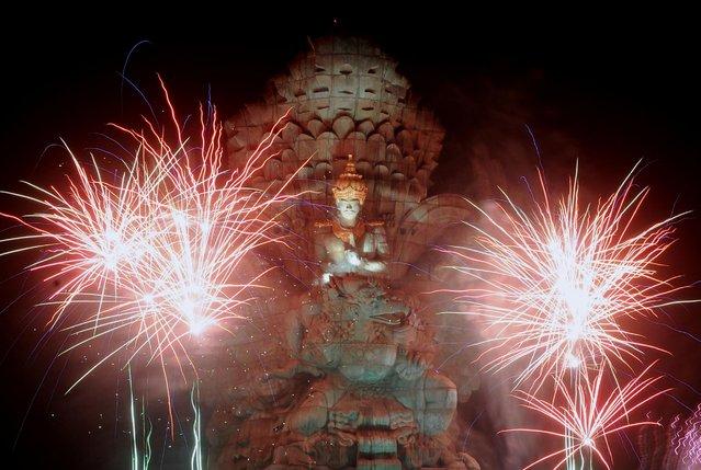 Fireworks explode over Garuda Wisnu Kencana statue during New Year's celebrations in Bali, Indonesia on January 1, 2020. (Photo by Fikri Yusuf/Antara Foto via Reuters)