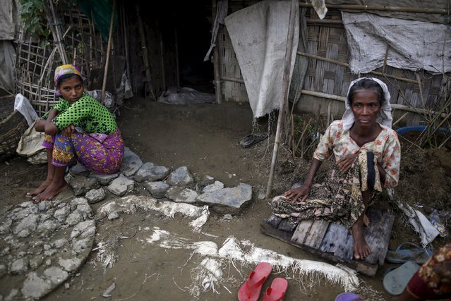 Rohingya people pass their time in a damaged shelter in Rohingya IDP camp outside Sittwe, Rakhine state on August 4, 2015. (Photo by Soe Zeya Tun/Reuters)