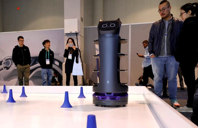 The BellaBot delivery robot maneuvers around a course in the PuduTech booth during the 2020 CES in Las Vegas, Nevada, U.S. January 8, 2020. (Photo by Steve Marcus/Reuters)