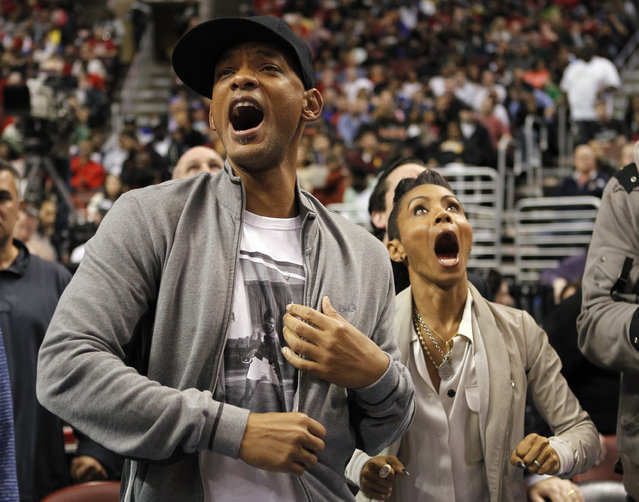 Part owners of the Philadelphia 76ers Will Smith and Jada Pinkett Smith react as the Heat play the 76ers in Philadelphia, March 2012. (Photo by Tim Shaffer/Reuters)