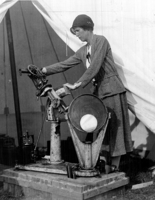 A Woman Astronomer is among the many noted scientists who will photograph the total eclipse of the sun Wednesday. She is Dr. Vibert Douglas of Montreal, shown here sitting up her instruments at Magog, Quebec, 1932. (Photo by AP Photo)