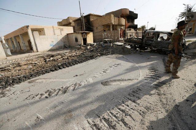 Damaged buildings are seen in Falluja, Iraq, June 26, 2016. (Photo by Thaier Al-Sudani/Reuters)