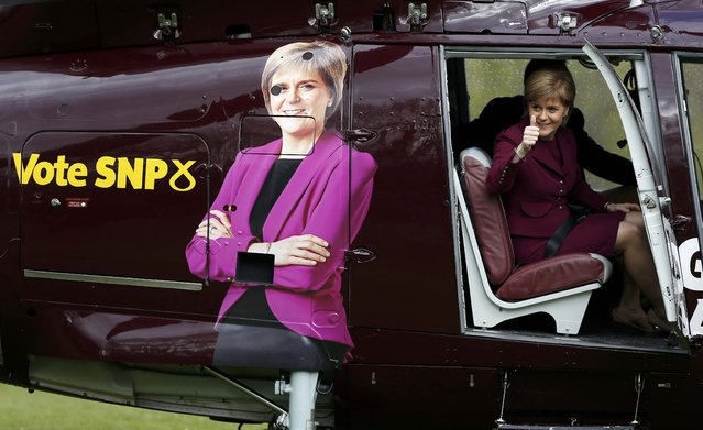 Nicola Sturgeon, the leader of the Scottish National Party, departs by helicopter from Prestonfield House in Edinburgh, Scotland, April 30, 2015. (Photo by Russell Cheyne/Reuters)