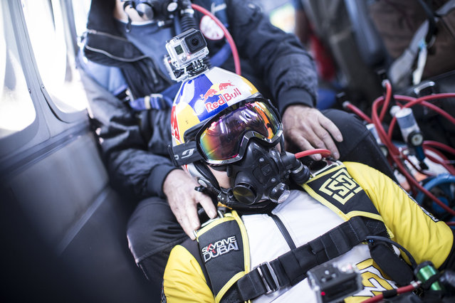 Fred Fugen and Vincent Reffet seen inside the plane before jumping at 33,000 feet (10 km) above the Mont Blanc, French Alps on May 31, 2014. Fearless skydivers jump from an altitude of 10,000 meters above the largest mountain in Europe. Frederic Fugen, 34, and Vincent Reffet, 29, leapt from a plane in the freezing skies above Mont-Blanc in the French Alps. The jump is from such a height the pictures show the curvature of the earth. (Photo by Dominique Daher/Barcroft Media)