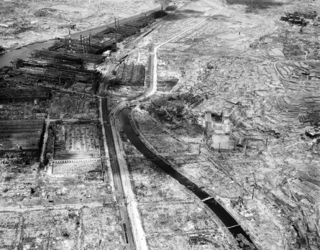 In this September 4, 1945 file photo, the remains of a factory are seen, upper left, in the southern Japanese city of Nagasaki, gutted by the Aug. 9 atomic bombing. On two days in August 1945, U.S. planes dropped two atomic bombs, one on Hiroshima, one on Nagasaki, the first and only time nuclear weapons have been used. Their destructive power was unprecedented, incinerating buildings and people, and leaving lifelong scars on survivors, not just physical but also psychological, and on the cities themselves. Days later, World War II was over. (Photo by AP Photo)