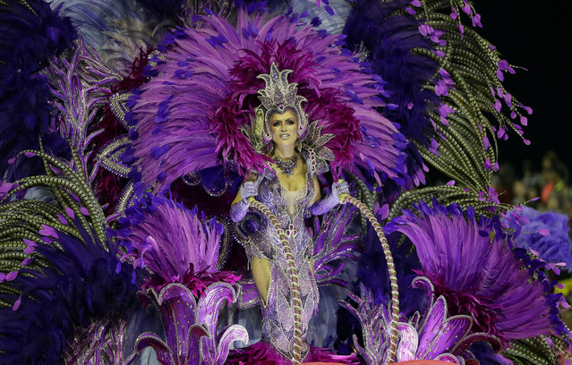 A dancer from the Mocidade Alegre samba school performs on a float during a carnival parade in Sao Paulo, Brazil, Sunday, February 23, 2020. (Photo by Andre Penner/AP Photo)