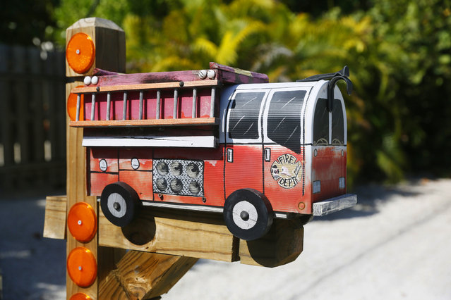 A mailbox in the shape of a fire truck is seen along the highway US-1 in the Lower Keys near Marathon in Florida, July 11, 2014. (Photo by Wolfgang Rattay/Reuters)