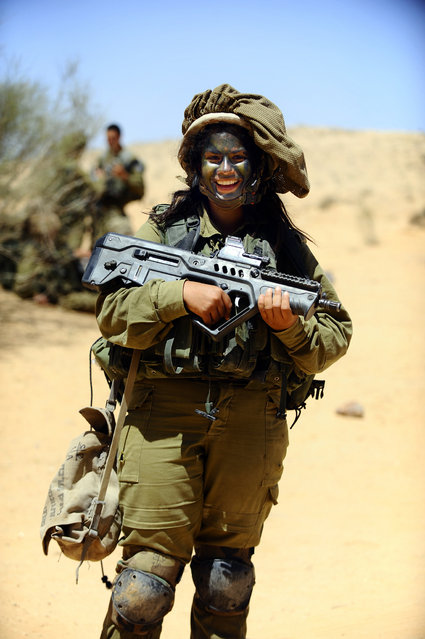 """Optimism"". A soldier of the Caracal co-ed battalion during a platoon exercise in southern Israel, 2012."