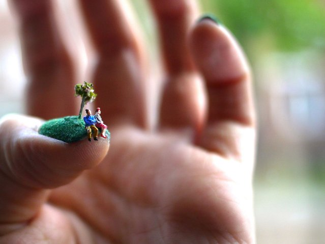 Thumb a lift: Alice spent hours painstakingly gluing the figure to her fingertips. (Photo by Alice Bartlett/Flickr)