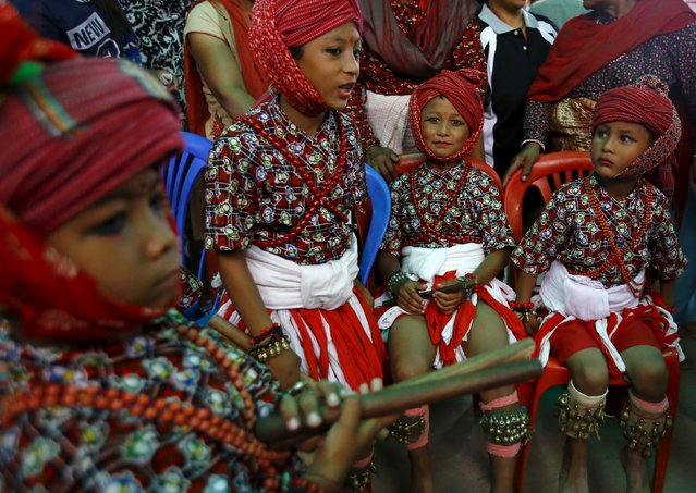 Boys in traditional attire wait to take part in a memorial rally dedicated to the people who were killed in the April 25 earthquake in Bhaktapur September 2, 2015. (Photo by Navesh Chitrakar/Reuters)