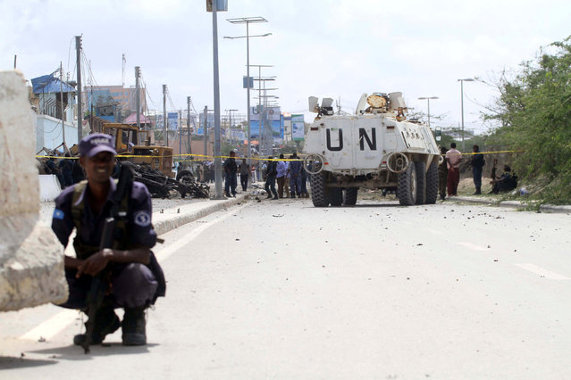 A United Nations peacekeepers' armoured personnel carrier (APC) is seen near the scene of a suicide bombing near the African Union's main peacekeeping base in Mogadishu, Somalia, July 26, 2016. (Photo by Ismail Taxta/Reuters)