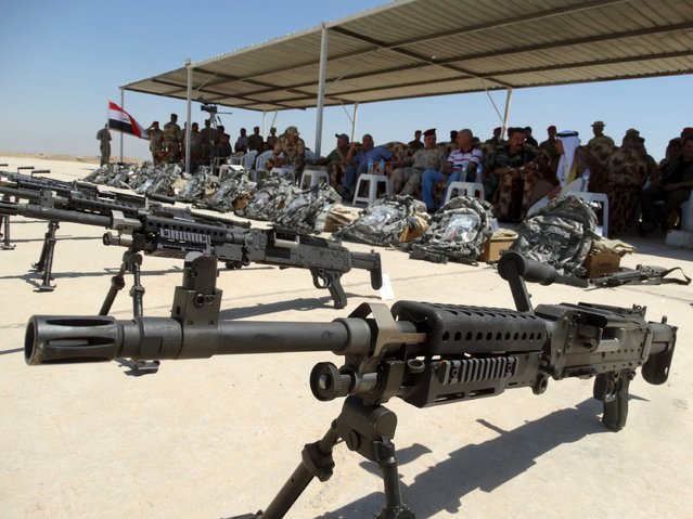 Weapons from the U.S. are displayed during a ceremony to present weapons to Sunni tribesmen at Camp Habbaniyah, in the eastern city of Ramadi September 3, 2015. (Photo by Reuters/Stringer)