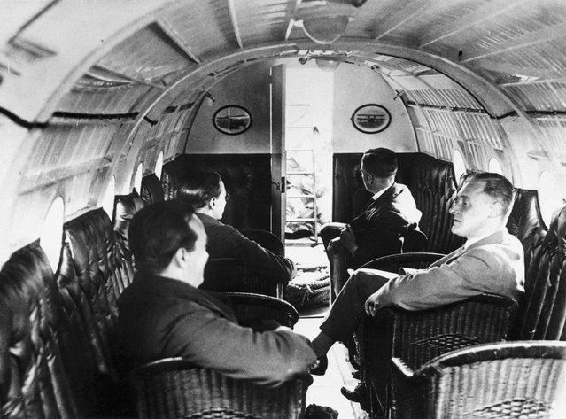R.J. Mitchell (1895-1937) sitting foreground right in the main cabin of a Supermarine Swan II, c 1920s. Trained as an engineer, Mitchell was led by his interest in aircraft to join the Vickers Armstrong Supermarine Company in 1916, where he soon became chief designer. He designed world- beating sea-planes for the Schneider Trophy races (1922-1931) and later the famous Spitfire, the triumph of which he did not live to see. He also designed the Swan. (Photo by Daily Herald Archive/SSPL/Getty Images)