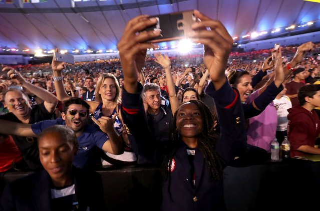 2016 Rio Olympics - Opening ceremony - Maracana - Rio de Janeiro, Brazil - 05/08/2016. Athletes from the United States and fans celebrate during the opening ceremony. (Photo by Damir Sagolj/Reuters)