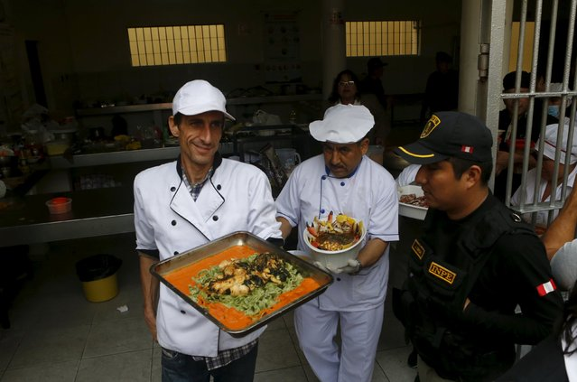 Swiss prisoner Alexander (L) and other inmates carry platters of food during a culinary competition at the Santa Monica female prison in Lima, September 10, 2015. (Photo by Mariana Bazo/Reuters)