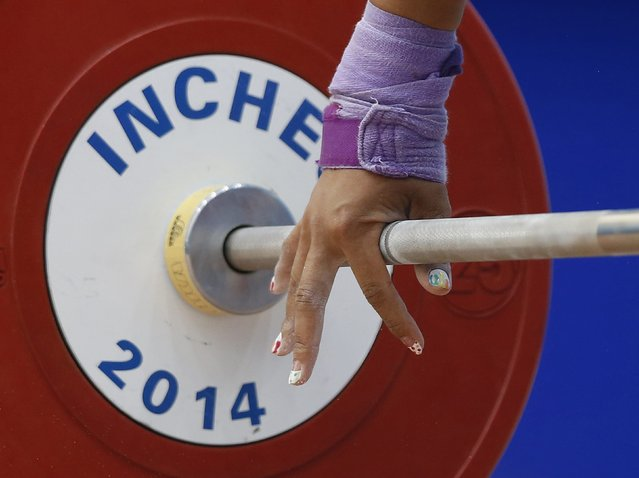 Japan's Kamiya Ayumi lifts 89kg on her second attempt in the women's snatch 75kg weightlifting competition at the Moonlight Garden Venue during the 17th Asian Games in Incheon September 25, 2014. (Photo by Olivia Harris/Reuters)