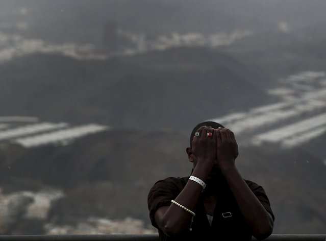 A Muslim pilgrim prays as he visits Hera cave, where Muslims believe Prophet Mohammad received the first words of the Koran through Gabriel, at the top of Mount Al-Noor during the annual haj pilgrimage in the holy city of Mecca, September 21, 2015. (Photo by Ahmad Masood/Reuters)