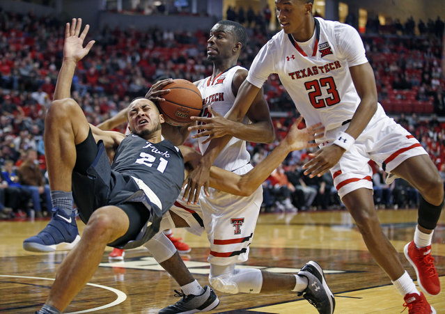 Texas Tech's Keenan Evans (12) and Jarrett Culver (23) defend Nevada's Kendall Stephens (21) during the second half of an NCAA college basketball Tuesday, December 5, 2017, in Lubbock, Texas. A defensive foul was called on the play. Texas Tech won 82-76 in overtime. (Photo by Brad Tollefson/AP Photo)