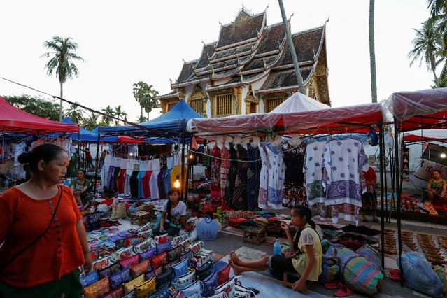 A night bazaar is seen in front of Haw Pha Bang Buddhist temple in Luang Prabang, Laos July 31, 2016. (Photo by Jorge Silva/Reuters)