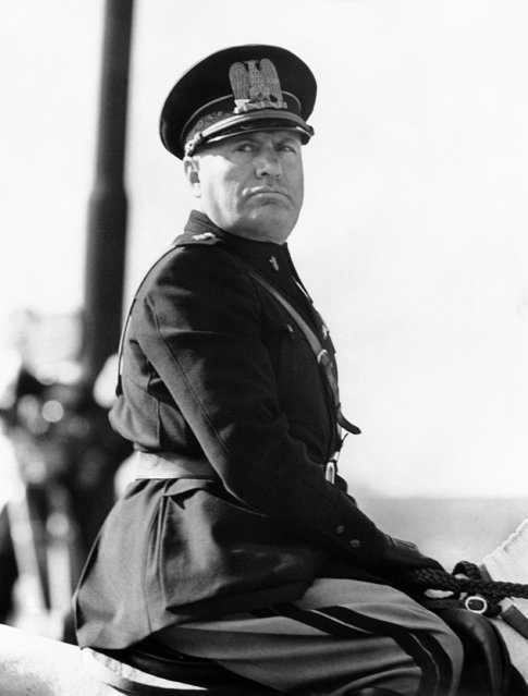 Benito Mussolini, in the newly introduced Fascist uniform, on his horse at a parade of police to commemorate the 13th anniversary of the foundation of the Metropolitan Police in Rome, Italy around October 20, 1938. (Photo by AP Photo)