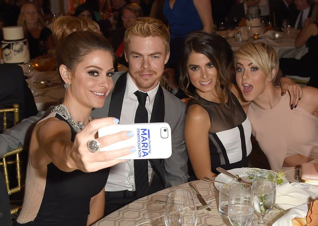 (L-R) Television personality/actress Maria Menounos takes a selfie photo with actor/dancer Derek Hough, actress Nikki Reed and actress Julianne Hough at The Kaleidoscope Ball – Designing the Sweet Side of L.A. benefiting the UCLA Children's Discovery and Innovation Institute at Mattel Children's Hospital UCLA held at Beverly Hills Hotel on April 10, 2014 in Beverly Hills, California. (Photo by Jason Merritt/Getty Images for Mattel Children's Hospital UCLA)