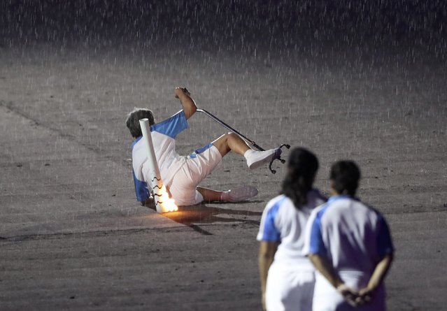 2016 Rio Paralympics, Opening ceremony, Maracana, Rio de Janeiro, Brazil on September 7, 2016. Brazilian Paralympic runner Marcia Malsar falls while carrying the torch as rain falls during the opening ceremony. (Photo by Ueslei Marcelino/Reuters)
