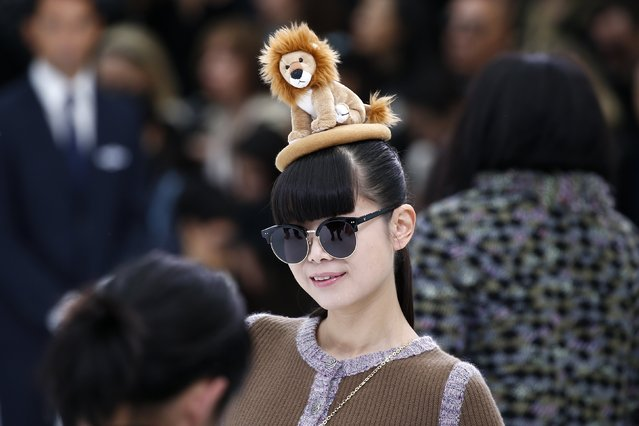 An unidentified guest wears a hat with a lion at the Grand Palais which is transformed into a Chanel airport before German designer Karl Lagerfeld's Spring/Summer 2016 women's ready-to-wear collection for French fashion house Chanel during Fashion Week in Paris, France, October 6, 2015. (Photo by Benoit Tessier/Reuters)