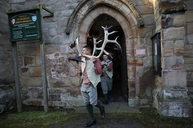 Dancers leave St Nicholas Church before the Abbots Bromley Horn Dance in Abbots Bromley, Britain, September 12, 2016. (Photo by Darren Staples/Reuters)