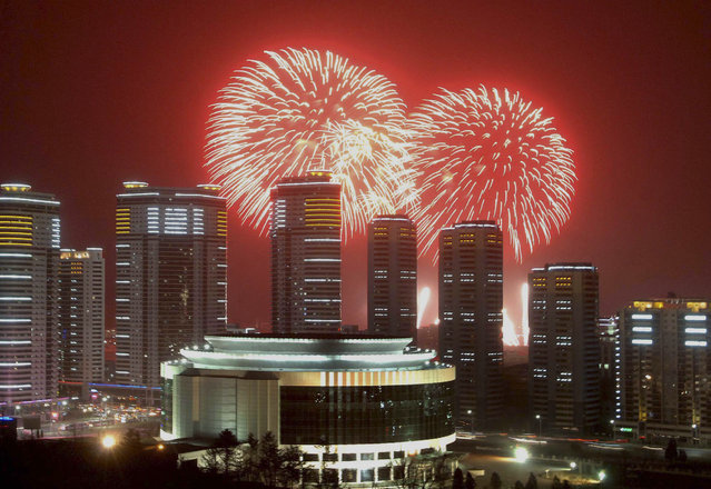 Fireworks explode in the sky over high rise buildings in Pyongyang, North Korea on  December 31, 2014. (Photo by Reuters/KCNA)