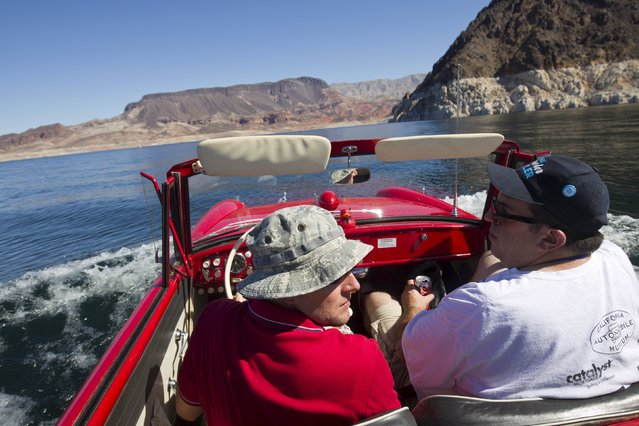 James Spear (L) of Henderson, Nevada and Josh Garrett of Placerville, California ride in a 1964 Amphicar 770 during the first Las Vegas Amphicar Swim-in at Lake Mead near Las Vegas, Nevada October 9, 2015. (Photo by Steve Marcus/Reuters)