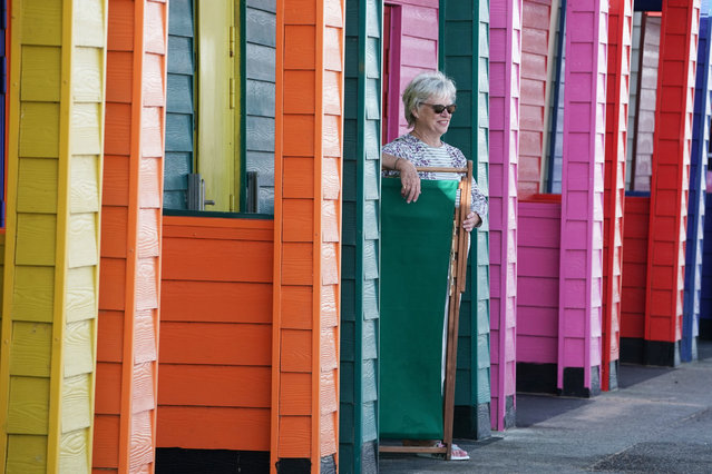 A woman enjoying the sunny weather on the pier at Saltburn-by-the-Sea, North Yorkshire on September 14, 2020, at the start of a week in which the UK is expected to bask in temperatures of more than 30° C. (Photo by Owen Humphreys/PA Images via Getty Images)