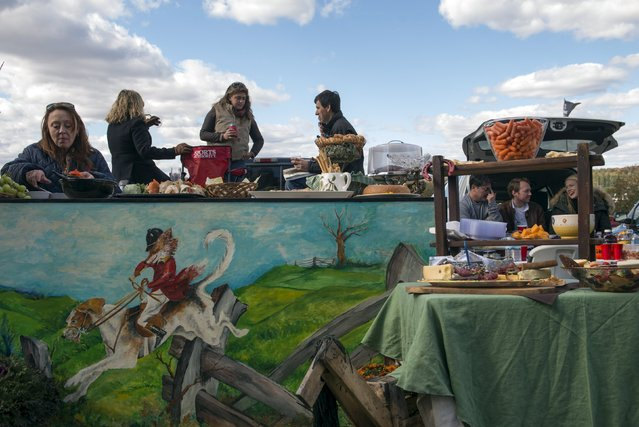Revellers attend a tailgate party at the Far Hills Race Day at Moorland Farms in Far Hills, New Jersey, October 17, 2015. (Photo by Stephanie Keith/Reuters)
